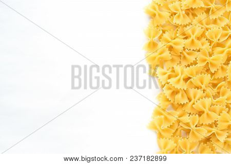 Farfalle Raw Farfallini Beautiful Laid Out Pasta With The Right, With A Side On White Isolated Backg