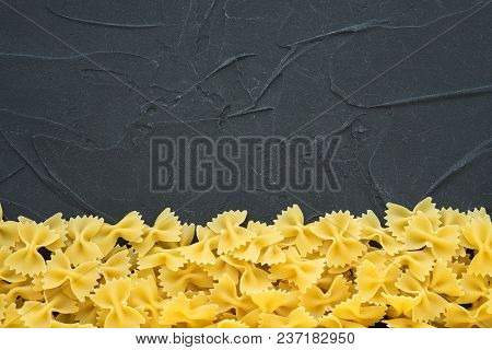 Farfalle Raw Farfallini Beautiful Decomposed Pasta With A Bottom On A Black Textured Background. Clo