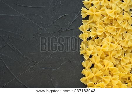 Farfalle Raw Farfallini Beautiful Decomposed Pasta With The Right, On Its Side On A Black Textured B