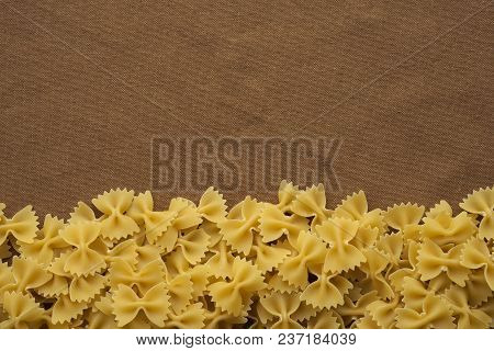 Farfalle Raw Farfallini Beautiful Decomposed Pasta From The Bottom On A Rustic Brown Textured Backgr