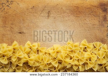 Farfalle Raw Farfallini Beautiful Decomposed Pasta With A Bottom On A Wooden Plank Texture Backgroun
