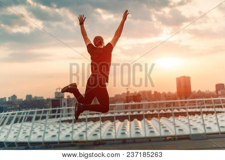 Silhouette Of A Person In A Jump. The Concept Of Victory, Achievement, Freedom.