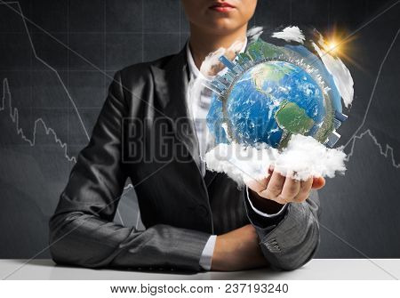 Closeup Of Businessman In Suit Keeping In Hands Earth Globe With Buildings, Business Sketches On Bac