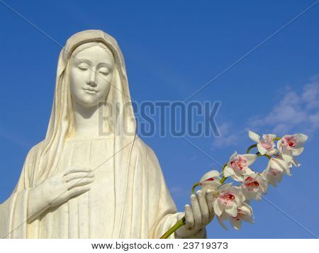 Statue Of Holy Mary Of Medjugorje Holding Flowers