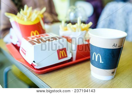 Moscow, Russia - April, 14, 2018: burger, coffee and French fries in McDonald's