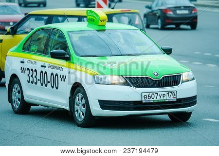 St. Petersburg, Russia - April, 17, 2018: taxi on the street of St. Petersburg