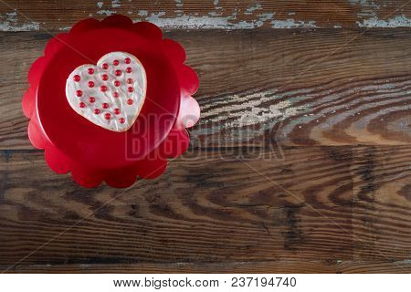 Poka Dot Heart Cookie On Cake Stand With Copy Space To Right