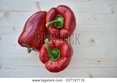Fresh Biologic Red Peppers On Wooden Background