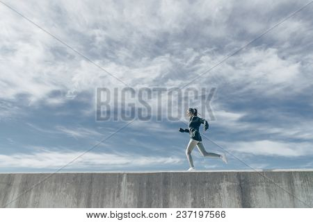 Active Athletic Girl Runs In The Open Air, Prepares For A Marathon, Trains