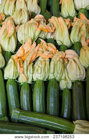 Fresh Green Zucchini With Flowers. Food Background.