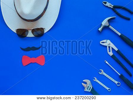 Happy Father's Day And Tools Colorful Tie And Hat On Blue Background. Place For The Text. Top View.