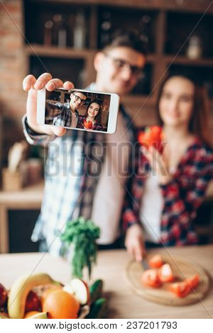 Husband and wife makes selfie on the kitchen
