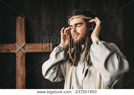 Jesus Christ listening to music with headphones