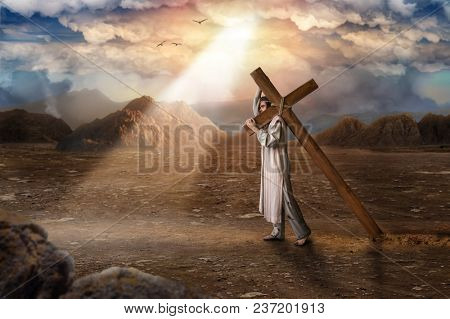 Great martyr with cross in desert, sun rays