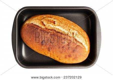 Baking Sheet With Freshly Baked Crunchy French Loaf Isolated On White Background