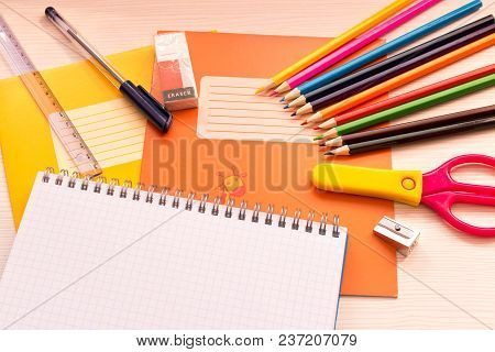Various School Accessories On The Desk . Back To School . With Empty Text Space .