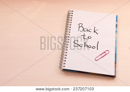 Notebook With The Inscription Back To School On The Desk . School Concept .