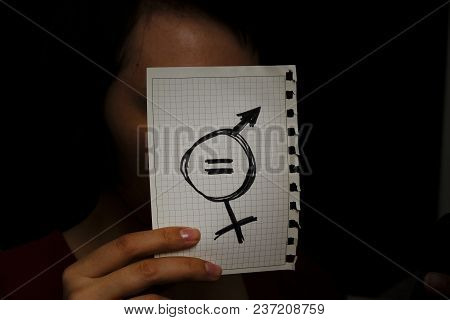 Closeup Of A Young Caucasian Woman In The Street Showing A Piece Of Paper With A Symbol For Gender E