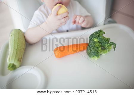 The Baby Is Eating Potatoes.