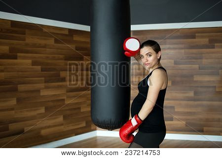 Sports And Fitness For Pregnant Women. Young Beautiful Pregnant Woman In Fitness Gym. Young Beautifu