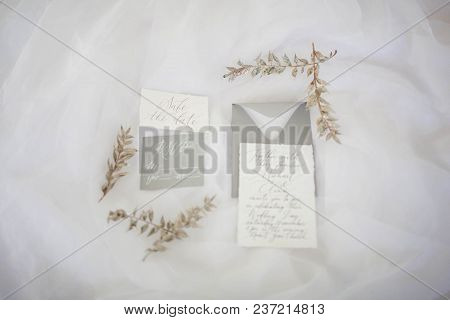 Wedding Printing On A White Background With Green Branches.