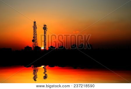Silhouette Electricity Pole,telecommunication Tower With Sunset On Sky Background.