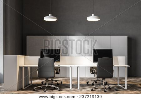 Front View Of A Black Chairs Open Office Corner With A Wooden Floor, Rows Of Computer Desks And Blac