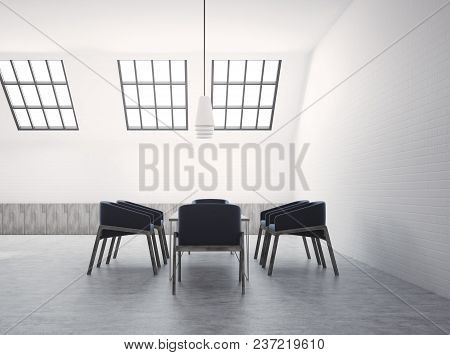 Attic White Brick Meeting Room Interior With A Concrete Floor And Dark Blue Armchairs Near A Boardro