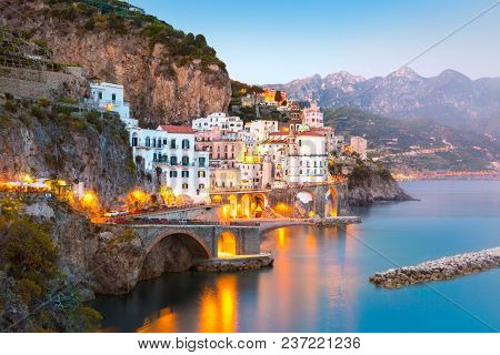 Night View Of Amalfi Cityscape On Coast Line Of Mediterranean Sea, Italy
