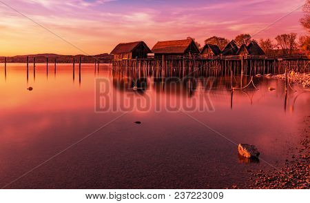 Colorfull Sunset At Lake Dwellings Of The Stone And Bronze Age In Unteruhldingen On Lake Constance,
