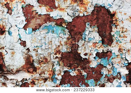 Old, Torn Bulletin Board. Street Empty Public Billboard, Blue Dirty Wall With Rust. Bright Colorful