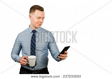 Young Businessman Dressed In Blue Shirt And Tie, Isolated On White Background