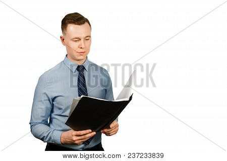 Young Businessman Dressed In Blue Shirt And Tie Holding Folder With Documents, Isolated On White Bac