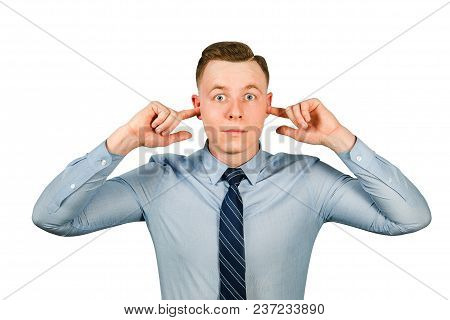 Young Businessman Dressed In Blue Shirt And Tie Closing His Ears From Noise, Isolated On White Backg