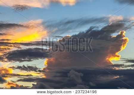 Fancy Shapes Of Clouds At Evening Sunset.