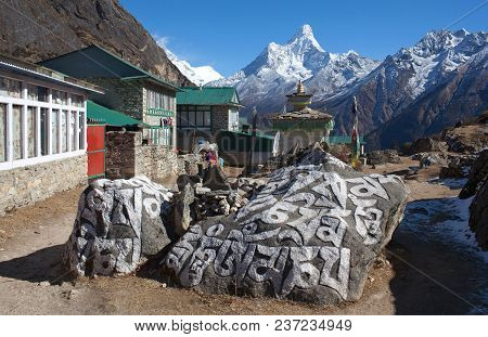 Mani Stones In Khumjung Village On The Way To Everest Base Camp, Nepal. On The Stones Is Written The