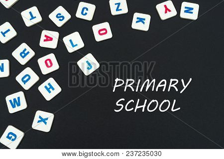 English School Concept, Text Primary School, Colored Square English Letters Scattered On Blackboard
