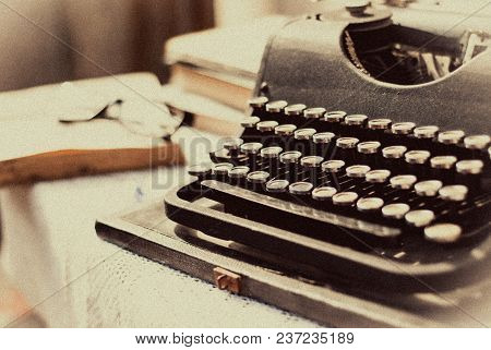 Vintage Typewriter, Old Books On Table