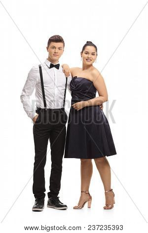 Full length portrait of elegantly dressed teenagers isolated on white background