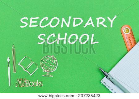 Concept School, Text Secondary School, School Supplies, Notebook, Ruler And Pen On Green Backboard