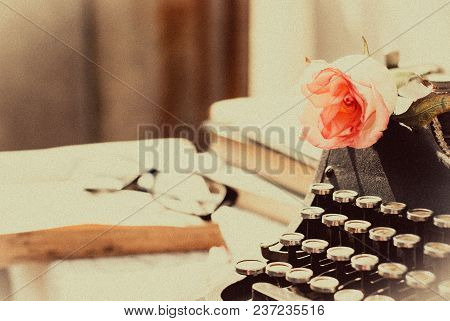 Vintage Typewriter With Pink Rose ,old Book On Table. Sepia Photo