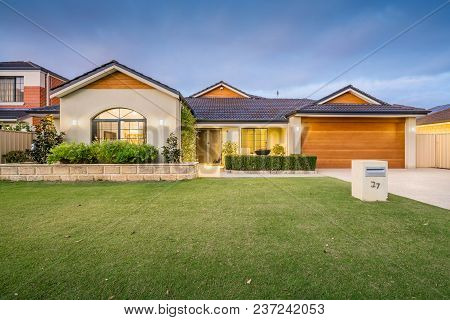 Modern Single Storey Suburban Home Front Elevation At Twilight. Perth, Western Australia. Photograph