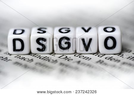 Word Dsgvo Formed By Wood Alphabet Blocks On Newspaper Abbrevation For German Law Closeup