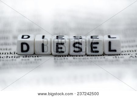 Word Diesel Formed By Wood Alphabet Blocks On Newspaper Closeup