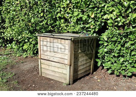 Worm Composting Wooden Box In A Garden