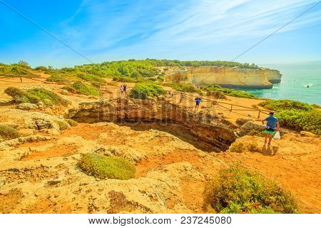 Benagil, Portugal - August 23, 2017: Benagil Cave See From The Top Of Rocky Cliff In Algarve Coast,