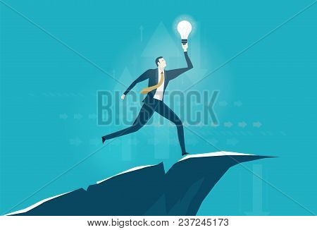 Businessmen Running With The Light Bulb On The Edge Of Canyon. Risky Situation Which Might Bring Win