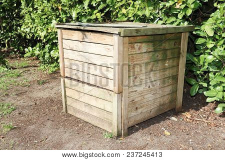 A Compost Bin With Wood Organic Material