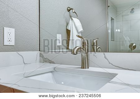 Luxury Bathroom Interior With Marble Top Washstand.