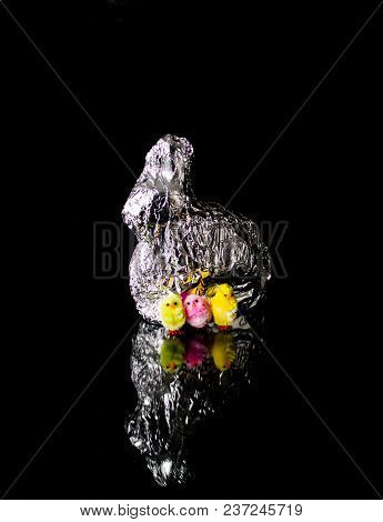 Reflection On Black Ground With Easter Bunny And Colorful Chicks